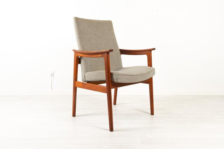Vintage Danish armchair in teak by Erik Kierkegaard for Høng Stolefabrik 1960s. Very comfortable and elegant Mid-Century Modern armchair in solid teak with grey wool upholstery. Curved armrests and tapered legs. High back for excellent back