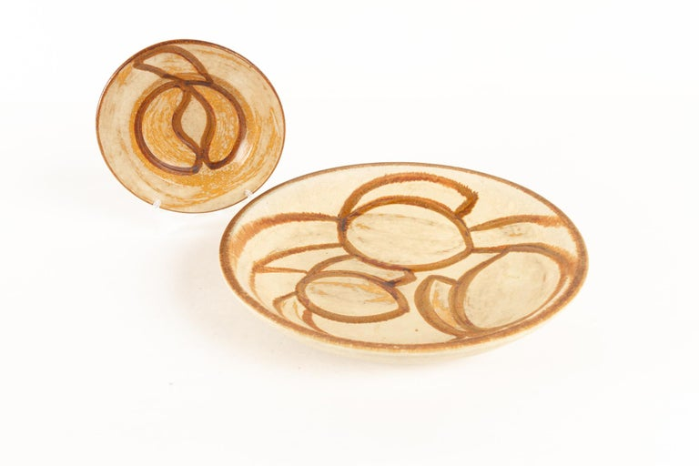 Vintage Danish ceramic dishes by Søholm 1960s, set of 2 Matching set of stoneware platters from Danish manufacturer Søholm on the island of Bornholm. Nature inspired decorations in earth tones.  This set consists of: 1 Large centerpiece dish,