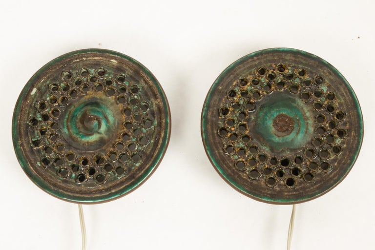 Vintage Danish ceramic sconces, 1960s, set of 2. Pair of beautiful handmade ceramic wall lights by Danish ceramist Ib Oluf Hansen for Demstrup Keramik. Green and brown glazing. Lamps stamped: Ib O. Demstrup DK 28-7-1975. Very good condition,