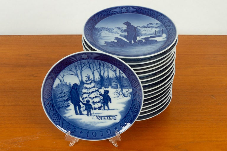 Vintage Danish Christmas platters, set of 16 16 hand painted porcelain plates from Royal Copenhagen in Denmark. The first Christmas plate from Royal Copenhagen was made in 1908 and a new motif has been made every year since. This sets is from