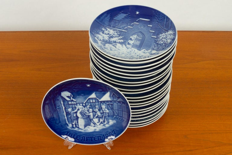 Vintage Danish Christmas platters, set of 23 23 hand painted porcelain plates from Bing & Grøndahl in Denmark. This sets is from 1965-1987. Each year is in this set. Can hang on the wall or be used as a dish. Dishwasher safe. Very good