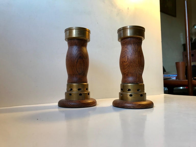 A pair of church candlesticks in oak and partially cross drilled bronze. These came out of a Church Near Vejen in the Eastern part of Denmark. The design is very plain and almost has an Art Deco appearance to them. They have not been polished