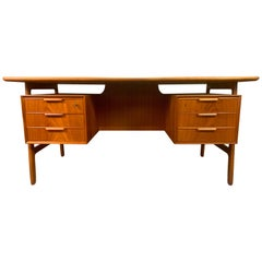 Vintage Danish Mid-Century Modern Teak Desk Model 75 by Gunni Oman for Omann Jun