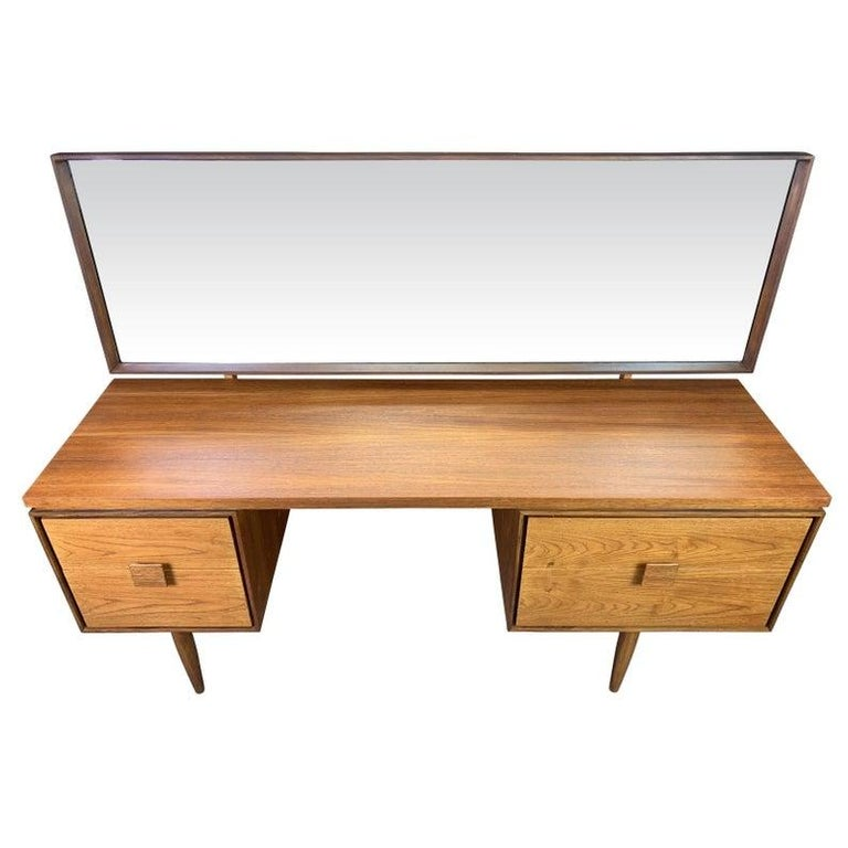 Here is from master Ib Kofod Larsen a beautiful teak vanity/desk from the the acclaimed