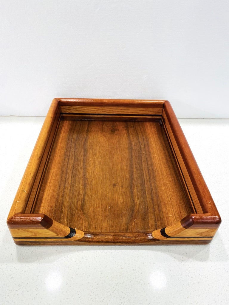 Mid-Century Modern paper and letter tray with streamline design, circa 1970. Comprised of handcrafted teak, maple, and walnut woods, creating stunning stripes with variegated wood tonalities and colors, and with beautiful wood grains throughout.