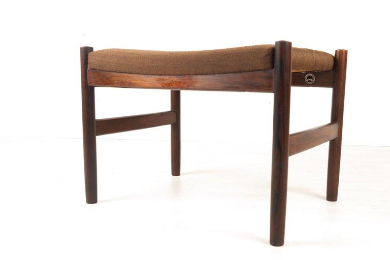 Vintage Danish rosewood stool by Spøttrup 1960s Danish Mid-Century Modern ottoman in solid rosewood / palisander by Hugo Frandsen for Spøttrup Stolefabrik. Straight round legs. Upholstered in original dark brown fabric.  Makers mark. Danish