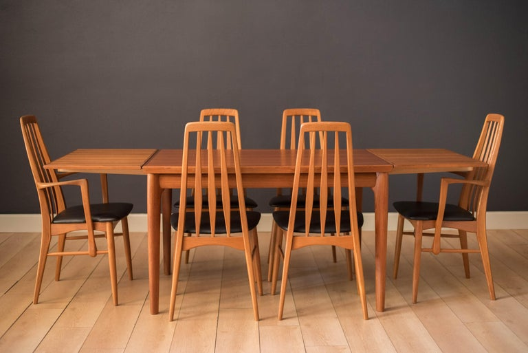 Mid-Century Modern 'Eva' dining chairs by Niels Koefoed for Hornslet Møbelfabrik. Features a sculptural teak frame designed with a tall backrest support. This set includes four side chairs and two captain armchairs. The seats have been newly