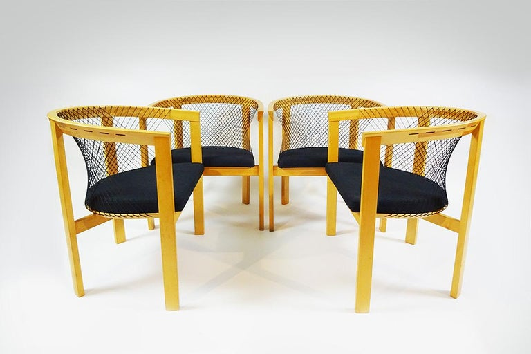A set of 4 unusual string backed vintage dining chairs in Beech wood by Niels Jørgen Haugesen.  Niels Jørgen Haugesen was born in Denmark in 1936. And worked with many notable Danish designers including Arne Jacobsen. He set up his own design