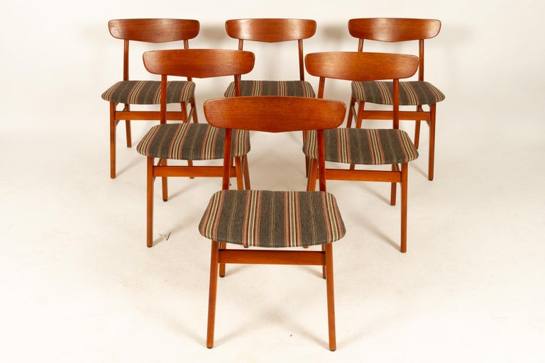 Vintage Danish teak dining chairs 1960s Set of 6 Danish dining room chairs with curved backs in teak and frame in stained beech. Vintage striped wool upholstery. This model of chair was very common in Denmark in the 1960s, and were produced by