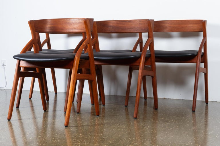 Vintage Danish teak dining chairs 1960s set of 6 Set of six elegant Mid-Century Modern dining chairs with frames in solid teak and new period correct leatherette upholstery and high density foam. Beautiful organic shaped frame with rounded tapered