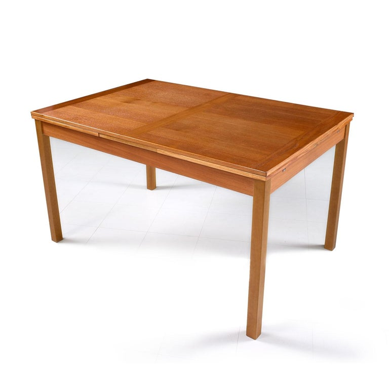 Made by Ansager Mobler, circa 1970s. The contrasting butcher block style wood grain on the leafs enhance the simple and Minimalist nature of this this Scandinavian design. Teak top with light colored beechwood legs. In the Classic style of Niels