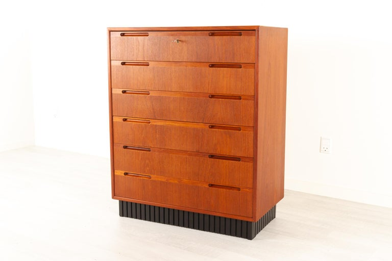 Vintage Danish teak dresser, 1960s Very expressive Mid-Century Modern chest of drawers with six drawers. Pulls are integrated in the drawer front for a more minimalistic appearance so the design really catches the eye. Top drawer has a lock with