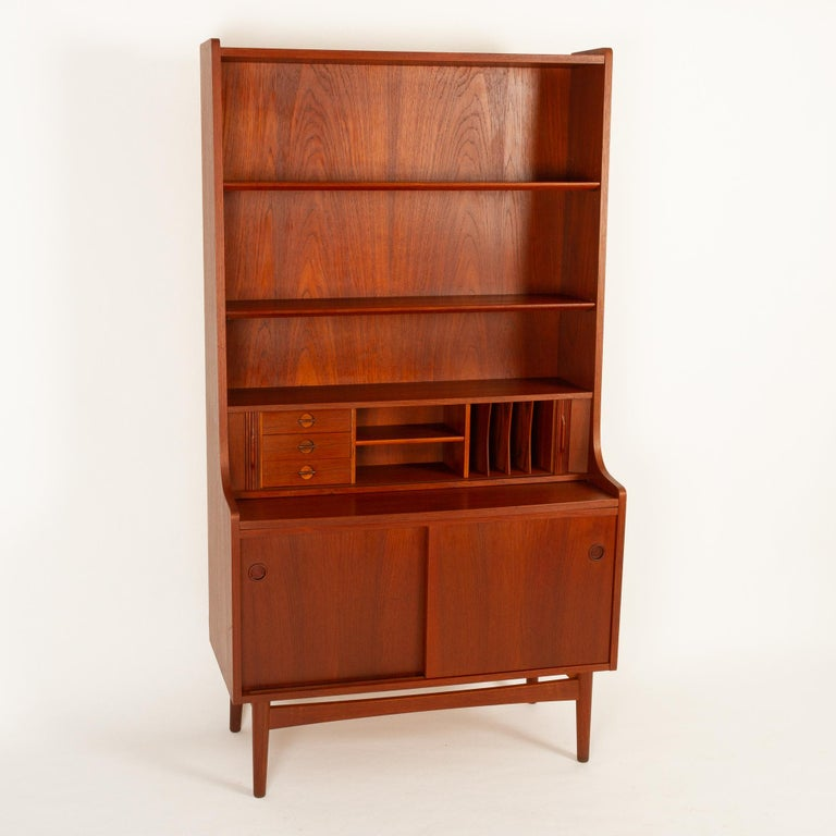 Vintage Danish teak high Secretaire by Johannes Sorth for Bornholms Møbelfabrik, 1960s. Made on the small island of Bornholm. Tall Mid-Century Modern secretary with draw out tabletop and tambour doors. Desk area with three small drawers, a shelf