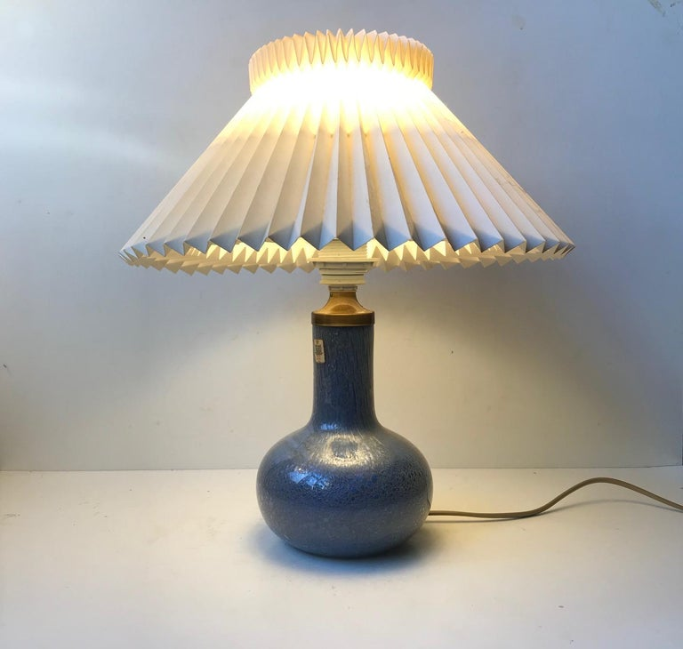 A vintage hand blown table lamp in blue troll glass that's a technique derived from making blister glass. Designed by Sidse Werner in 1975 and manufactured by Holmegaard in Denmark during the late 1970s. Notice that the shade is not included. Please