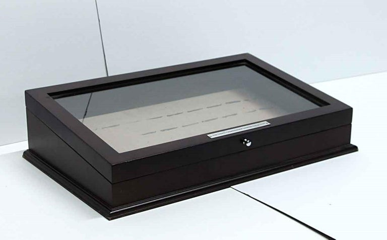 Dark tone vintage wood jewelry or cigar box with a clear glass top. Signed in Chrome,