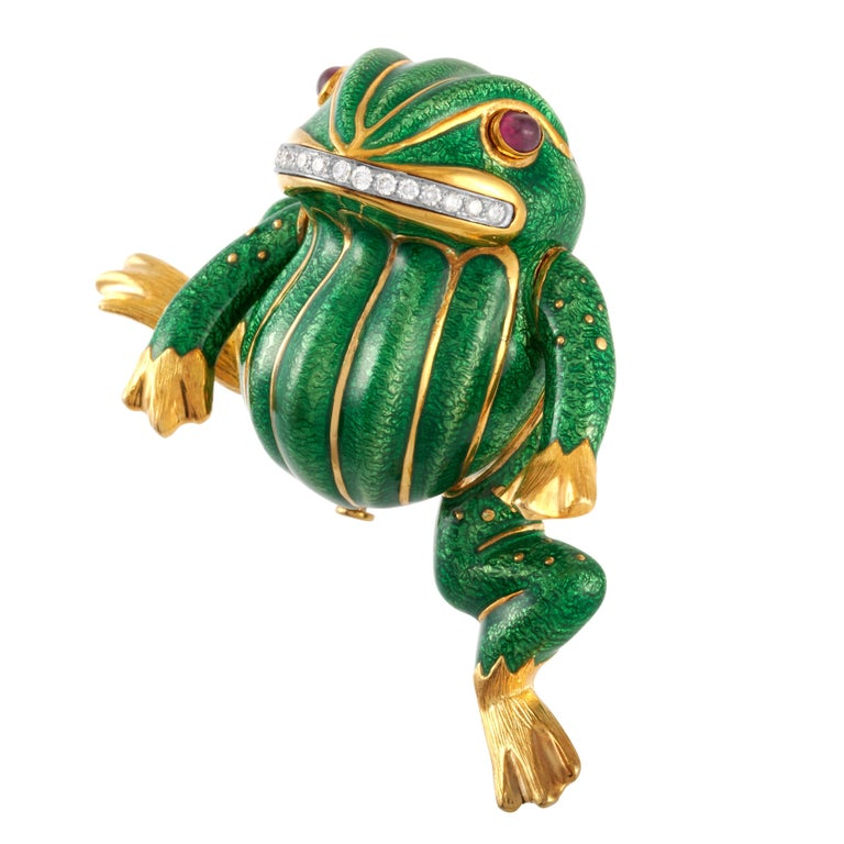 Vintage David Webb green enamel, diamond and cabochon ruby Angry Frog brooch in 18k yellow gold and platinum, accompanied by a David Webb certificate of authenticity.   This iconic whimsical David Webb piece features 15 round brilliant cut diamonds