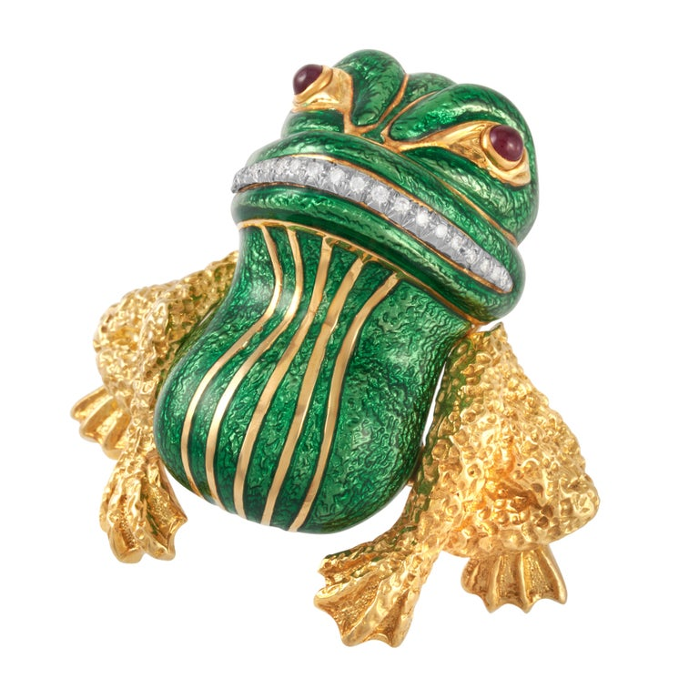 Vintage David Webb green enamel, diamond and cabochon ruby Bull Frog Brooch in textured 18k yellow gold and platinum, accompanied by a David Webb certificate of authenticity.   This iconic whimsical David Webb piece features 20 round brilliant cut
