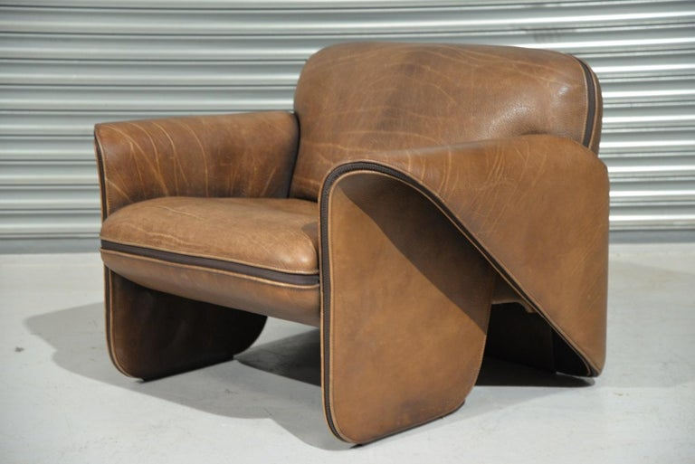 Discounted airfreight for our International customers (from 2 weeks door to door)  Ultra rare vintage De Sede DS 125 armchair by Gerd Lange in 1978. These sculptural pieces are upholstered in 3mm-5mm thick neck leather with a decorative zipper