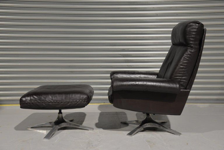 Discounted airfreight for our US and International customers (from 2 weeks door to door)  We are delighted to bring to you a highly desirable and rarely available vintage 1970s De Sede DS 31 high back swivel leather armchair with ottoman. Hand built