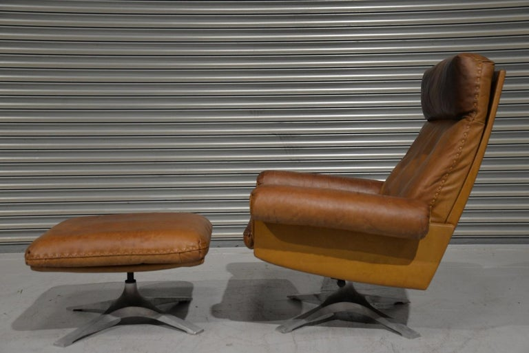 Discounted airfreight for our International customers (from 2 weeks door to door)  We are delighted to bring to you a highly desirable and rarely available vintage 1970s De Sede DS 31 high back swivel lounge armchair with ottoman. Hand built in the