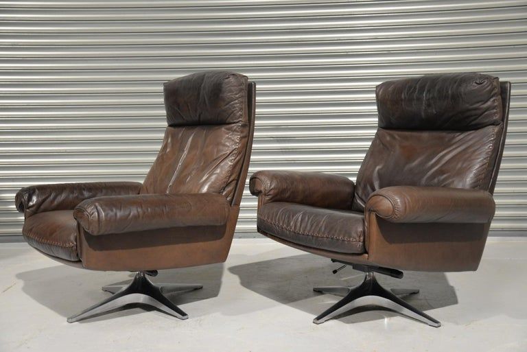 Discounted airfreight for our US and International customers (from 2 weeks door to door)  We are delighted to bring to you two vintage De Sede DS 31 highback swivel armchairs. Hand built in the early 1970s by De Sede craftsman in Switzerland these