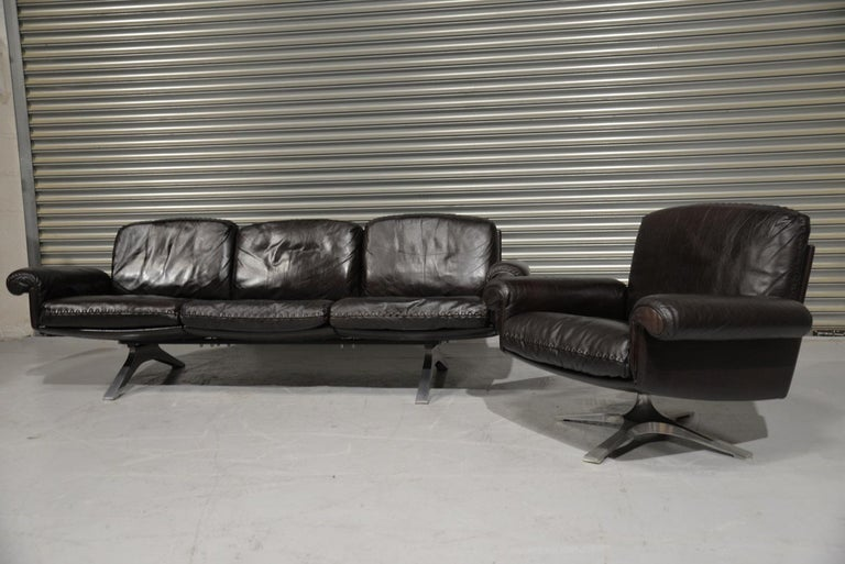 We are delighted to bring to you a Vintage de Sede DS 31 three-seat sofa and swivel lounge armchair. Built in the 1970s by De Sede craftsman from Switzerland these pieces are in beautiful soft dark aniline leather with superb whipstitch edge detail.