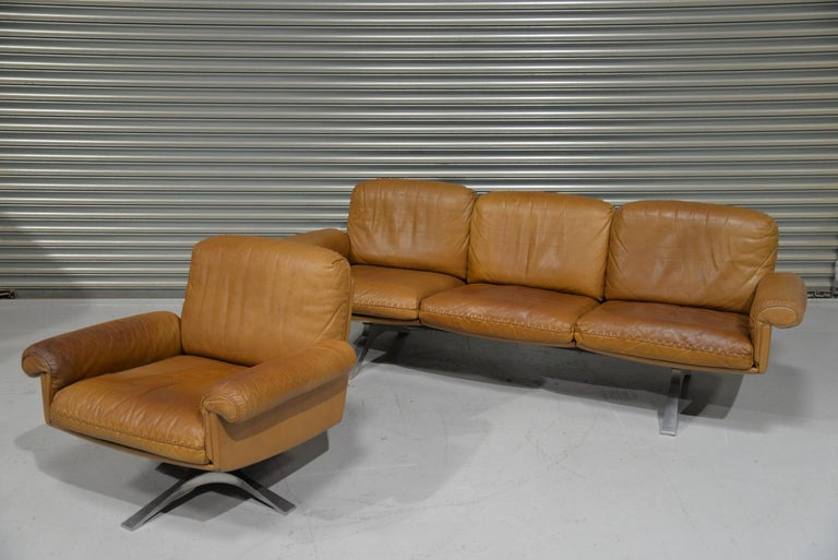 Discounted airfreight for our US and International customers ( from 2 weeks door to door)  A vintage De Sede DS 31 three-seat sofa and matching swivel lounge club armchair. This vintage sofa and matching swivel club armchair were built in the