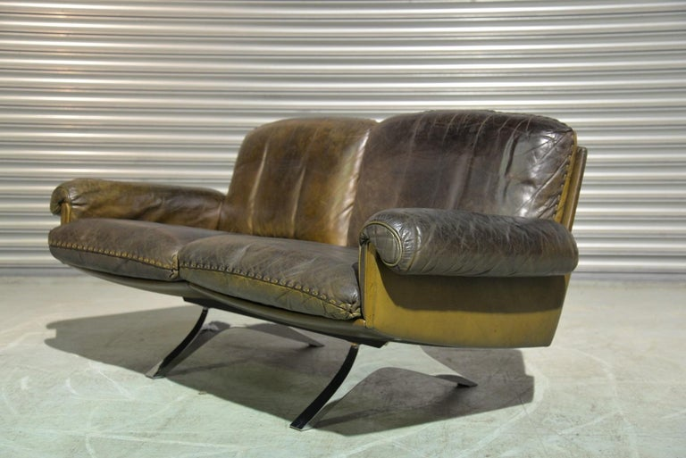 Discounted airfreight for our US and International customers (from 2 weeks door to door)  We are delighted to bring to you a vintage 1970`s de Sede DS 31 two-seat sofa or loveseat in olive/brown aniline leather with superb whipstitch edge detail.