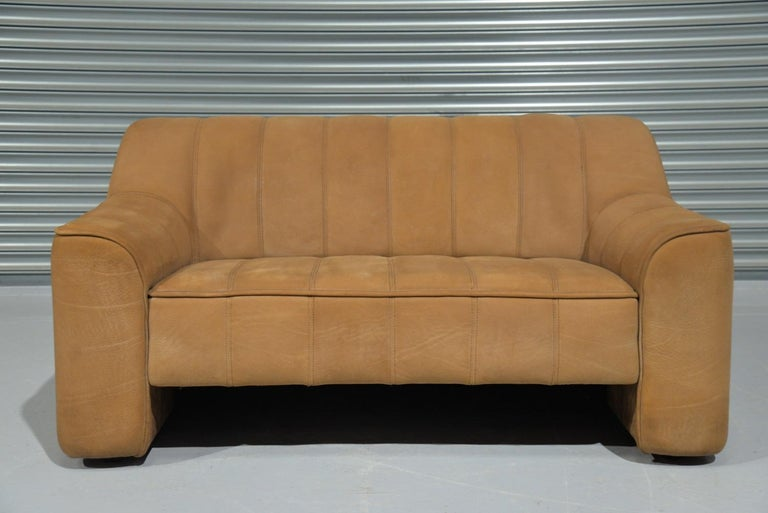 Discounted airfreight for our US and International customers (from 2 weeks door to door)  We are delighted to bring to you a vintage 1970`s De Sede DS 44 two-seat sofa or loveseat in thick buffalo leather with a soft silky texture similar to suede.