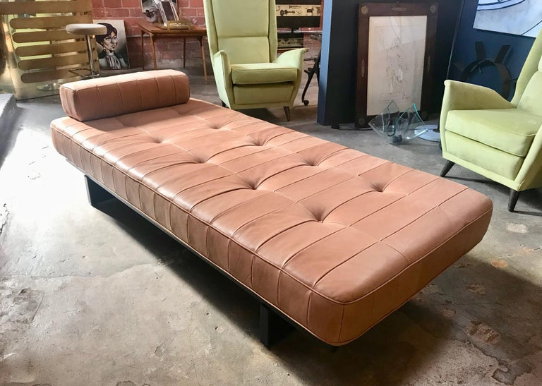 Rare original De Sede DS 80 daybed with one bolster patchwork cushion. Hand built in the 1960s to incredibly high standards by De Sede craftsman in Switzerland. The daybed stands on a black wooden frame and is extremely comfortable, upholstered in