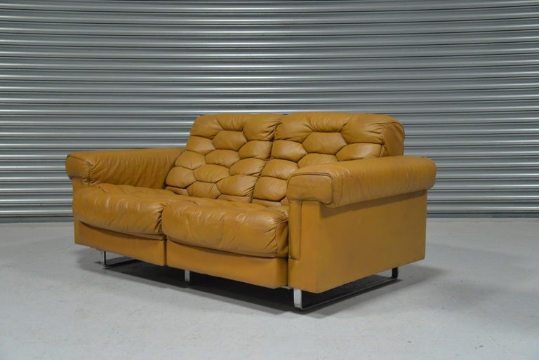 Discounted airfreight for our US and International customers (from 2 weeks door to door)  We are delighted to bring to you a beautiful two-seat reclining sofa from De Sede of Switzerland. Designed by Robert Haussmann with a honeycomb structure, this