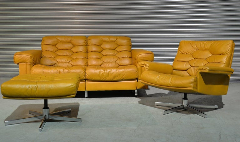 Discounted airfreight for our US and International customers ( from 2 weeks door to door )   We are delighted to bring to you a beautiful two-seat reclining sofa, matching swivel armchair and ottoman from De Sede of Switzerland. Designed by Robert