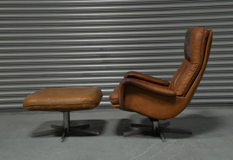 Discounted airfreight for our US and International customers (from 2 weeks door to door)  We are delighted to bring to you an ultra-rare and highly desirable De Sede S 231 swivel leather armchair and ottoman. Built in the late 1960s by De Sede
