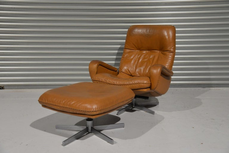 We are delighted to bring to you an ultra-rare and highly desirable De Sede S 231 vintage lounge swivel armchair and ottoman. Built in the late 1960s by De Sede craftsman from Switzerland this same chair was used as a prop in the 1969 James Bond
