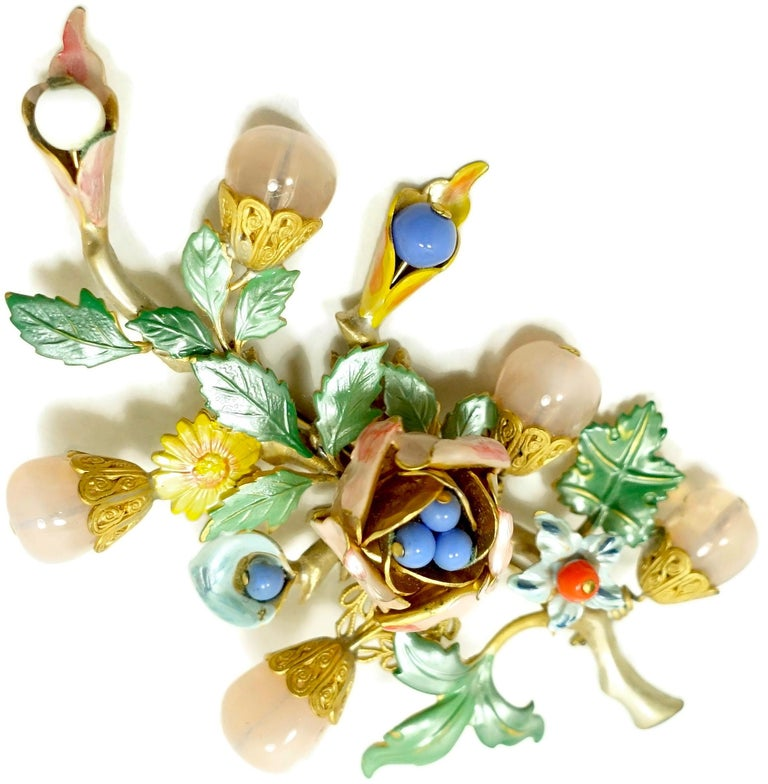 """This vintage 1930s brooch has a floral design with multi-color enameling and bead accents in a gold tone setting.  In excellent condition, the brooch measures 3-3/4"""" x 2-1/2""""."""