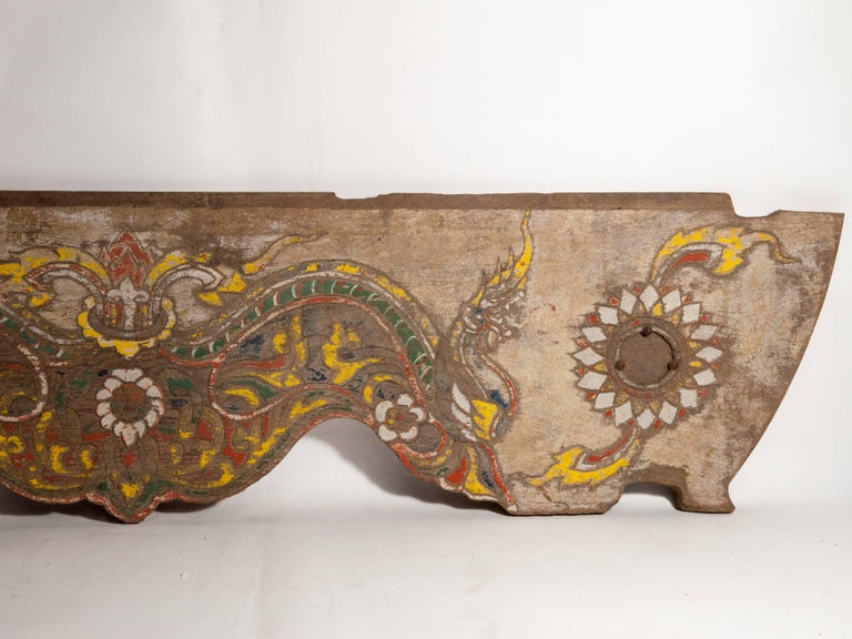 Vintage decorative cart panel. Naga motif, mid-20th century, North Thailand Offered by Bruce Hughes. This was a once brightly colored decorative panel from a northern Thai two wheeled cart, and incorporates representations of two Naga. Naga are of