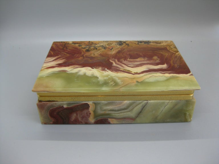 Beautiful decorative colorful natural onyx stone stash/jewelry box. Has brass accents. The natural color and form is wonderful. In very nice original condition with stunning colors. handmade and opens and closes as it should. Measures: approximate 6