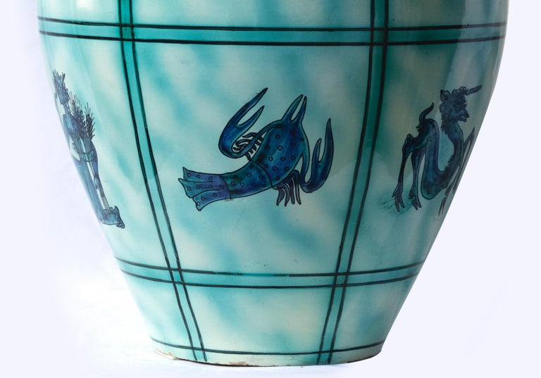 Deruta ceramic vase is a wonderful colored vase realized in the 1930s.  Very good conditions.  Ceramic vase light blue colored and decorated with different figures  Marked under the base Deruta.  Deruta is a small town of just under 10