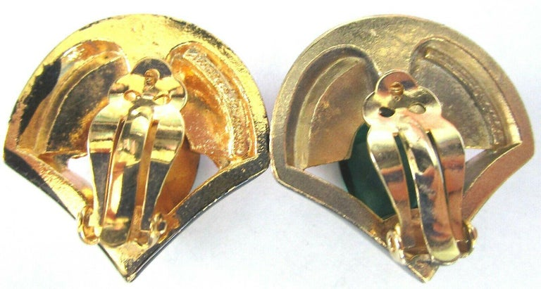 Beautiful Modernist design Clip-on Earrings. Each set with Pink Baguettes and Green Teardrop CZs, enhanced with Black Enamel surround. Gold plate mounting. Measuring approx. 1.25