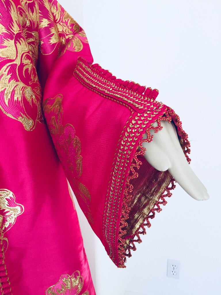 Elegant vintage brocade designer Moroccan kaftan, embroidered with pink and gold. This chic Gypsy Bohemian maxi dress brocade kaftan is embroidered and embellished with handwoven thread trim.  It is a slip on, the button does not open. One of a kind