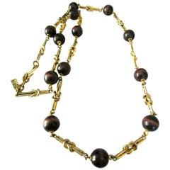 Vintage Designer Yves Saint Laurent Long Golden Knot Link Necklace Signed YSL
