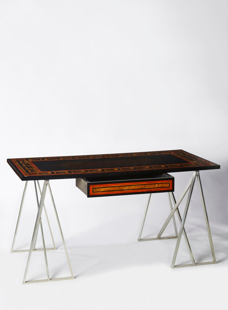 Elegant vintage desk in lacquered wood top and steel trestles.  1 drawer. Attributed to Maison Charles. France, 1960s.
