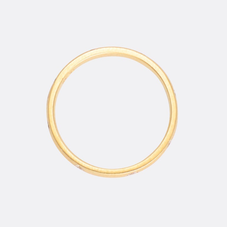 A cute vintage diamond ring in 18k gold. It dates from the 1980s, fully set with little brilliant cut diamonds. It's simple, but well executed - a timeless design.  STONES  8 brilliant cut diamonds - total carat weight 0.16ct  RING SIZE 6.75