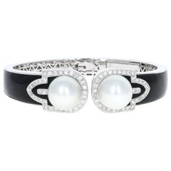 Vintage Diamond, 18 Karat White Gold and Pearl Bangle Cuff with Onyx