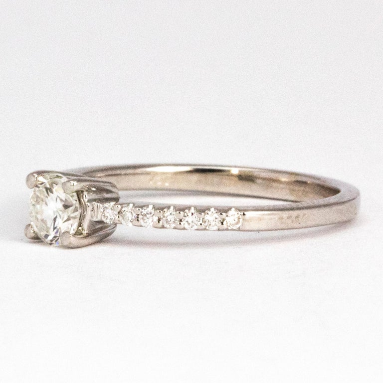 This simple solitaire ring has a central brilliant cut diamond measuring 35cts. The shoulders have diamonds running through on to the band. The diamonds on the shoulders each and sit in delicate settings on the band.   Ring Size: L 1/2 or 6