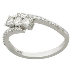 Vintage Diamond and 18 Karat White Gold Twist Ring