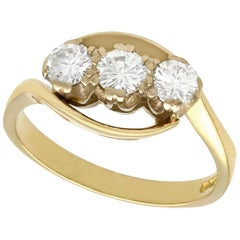 Vintage Diamond and Yellow Gold Twist Trilogy Engagement Ring