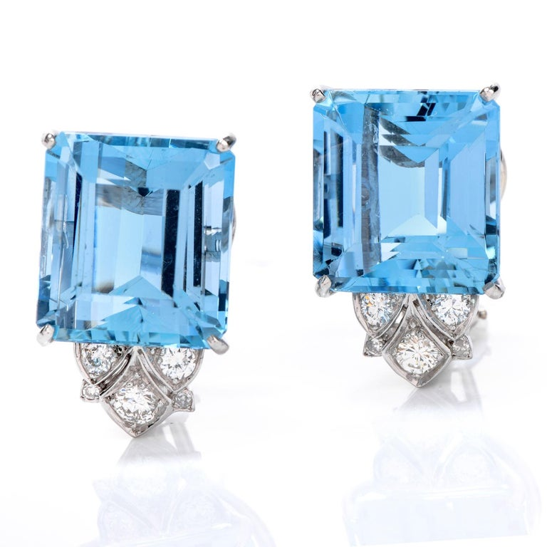 Admire these angelic Diamond Aquamarine & Platinum earrings every day!   These large emerald-cut Aquamarines are eye-clean and sky blue.  The elegance is evident in its fitting emerald cut and platinum prong setting.   The aquamarines are crowned