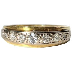 Vintage Diamond, Platinum and 18 Carat Gold Seven-Stone Band