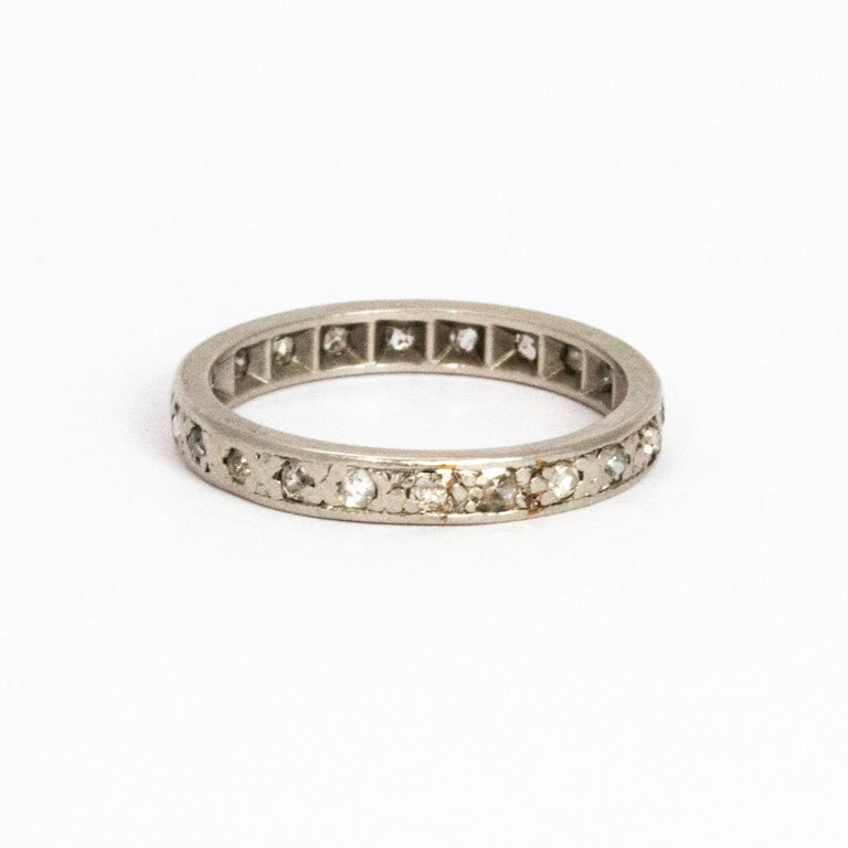 Classic sparkling diamond eternity band modelled out of platinum.   Ring Size: N or 6 3/4